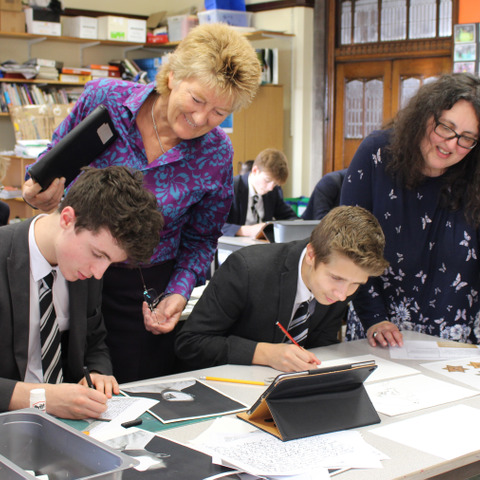 Pupils working with art teacher Mrs Laura Turner (standing left) and visiting Holocaust art educator Caroline Slifkin (standing right)