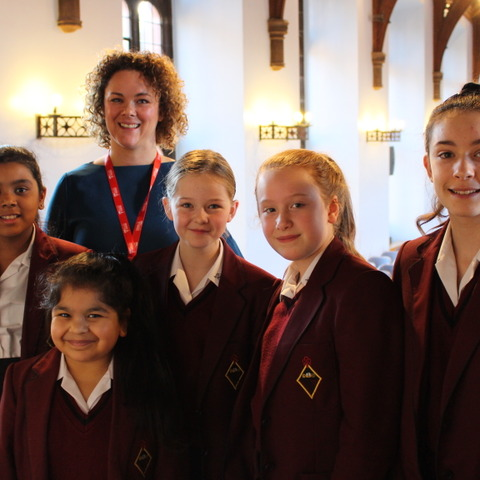 Year 7 pupils with Key103 Charity Manager Michelle Williamson, who visited to collect the girls' donation