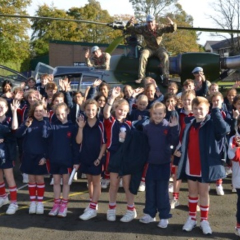 Pupils at Highfield Prep School and the Gazelle Helicopter