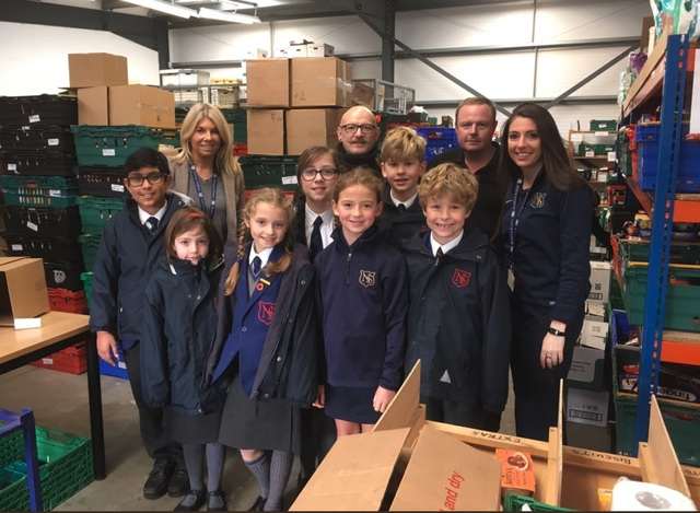 Norwich School pupils with Norwich Food Bank voluntters