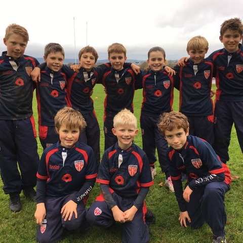 The Paragon's U10A rugby team in their poppy rugby shirts, commemorating Armistice Day