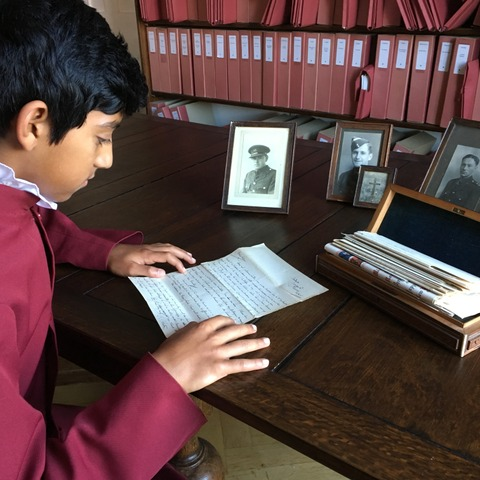 A chorister reads the letter from George Garton