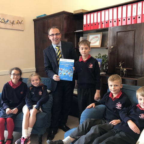 Pupils awarded 'Gold Status' certificate with Head of Juniors, Mr Roberts