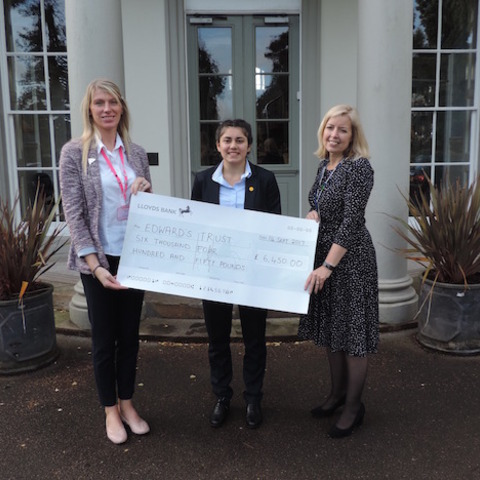 Sixteen-year-old Emily Ratchford (centre) and Saint Martin's fundraising co-ordinator Mrs King (right) present Lucy Goodway from Edward's Trust with t