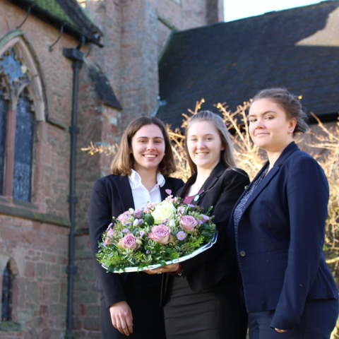 Saint Martin's Head Girl and Deputy Head Girls Sophie, Anya and Elizabeth laid a wreath at the St Alphege memorial stone of school founders Christine