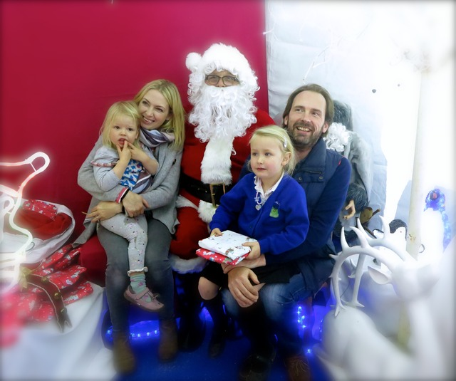 Sompting Abbotts' Santa with a local family in the Grotto
