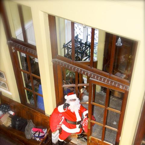 Santa captured sneaking through the school main doors