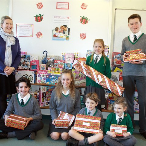 Children from St Andrews with Ms Stammers and their gifts for the Salvation Army