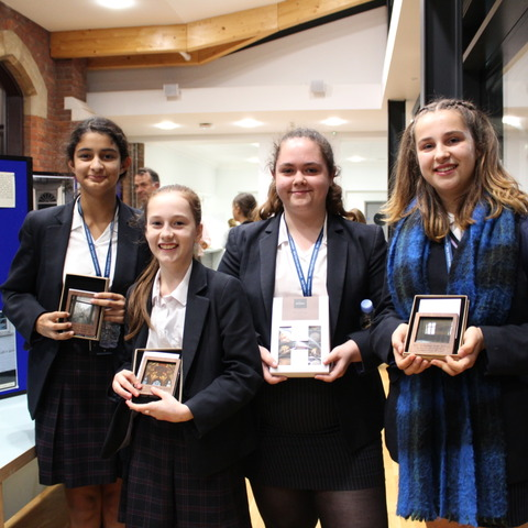 Picture this: winners of the Sydenham High History Photography competition with their trophies