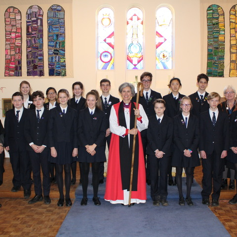 The Bishop of Dorking with staff, students and School Chaplain